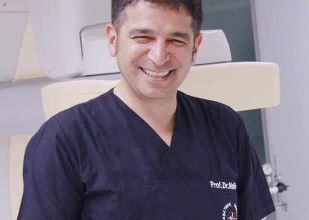 Dr. Melih Us